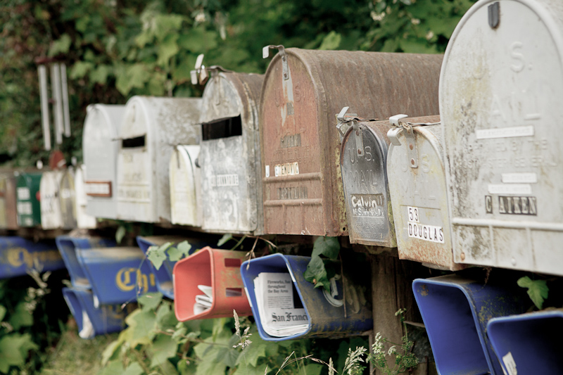 Row of old mailboxes in Point Reyes Station, CA