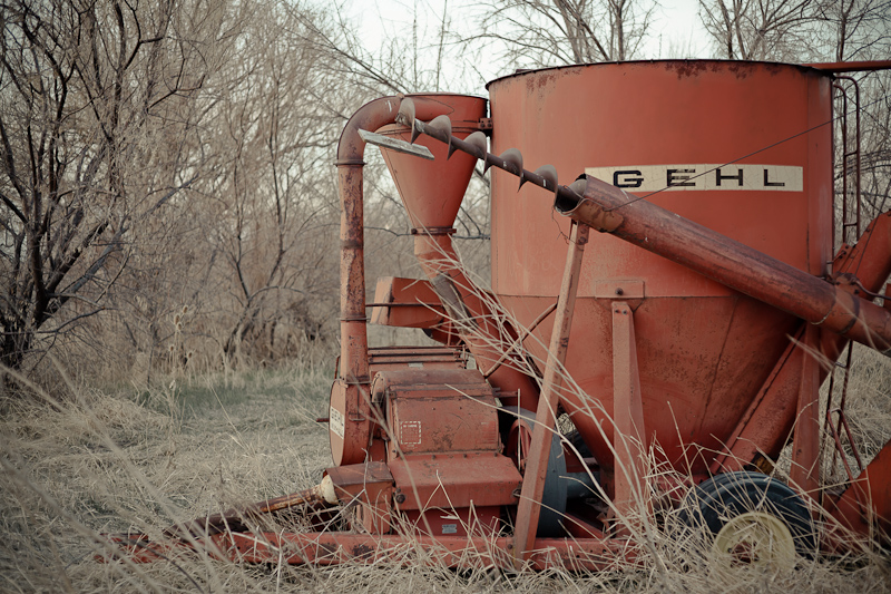 Trees and Gehl farm equipment in a field along Geneva Road in Provo, Utah