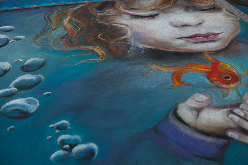 Girl holding a goldfish chalk art at Chalk The Block 2012 in Provo, UT