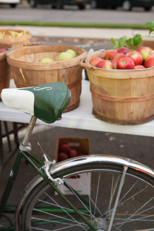 Bicycle and apples in bushel baskets at the Provo Fresh Wednesday Farmer's Market in Downtown Provo