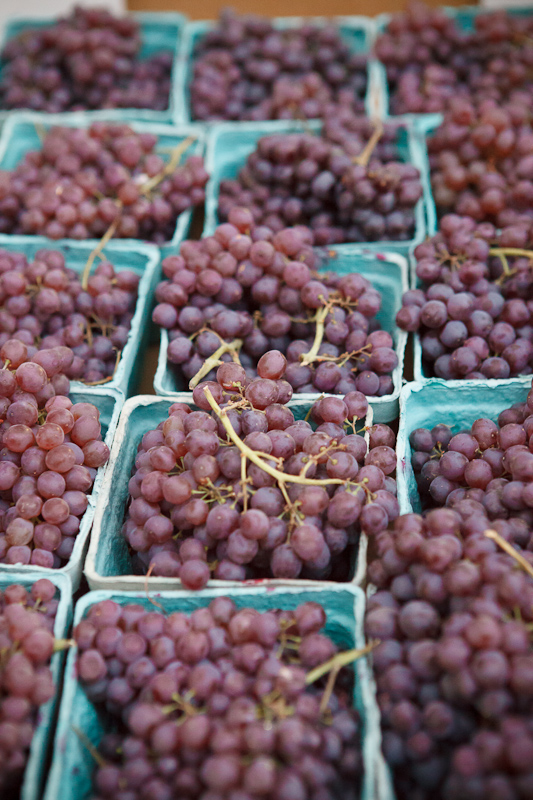 Baskets of red grapes at the Provo Fresh Wednesday Farmer's Market in Downtown Provo