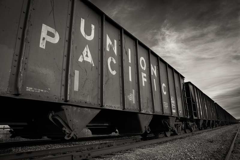 Black and white Union Pacific train on railroad tracks in Orem, UT