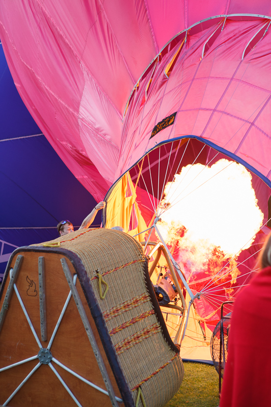 Fire filling the Bank of American Fork Pink Pig hot air balloon.