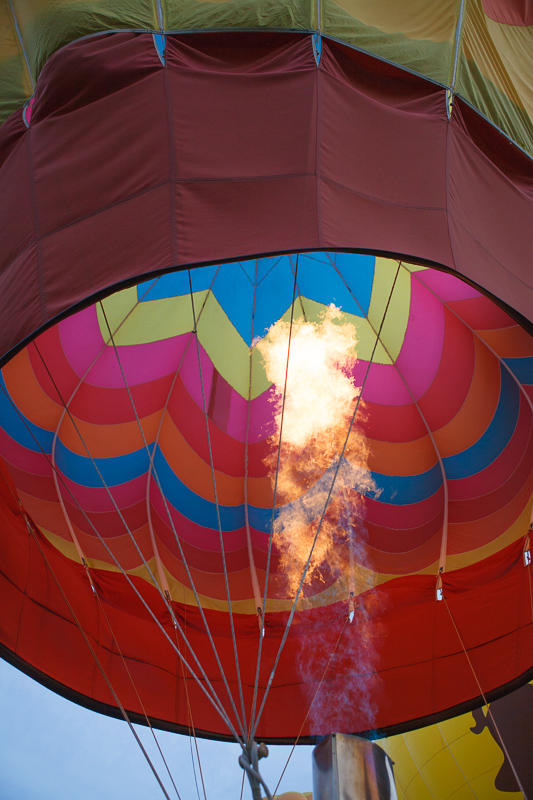 Fire filling a multicolored hot air balloon at the Provo, Utah Freedom Festival on the 4th of July, Independence Day