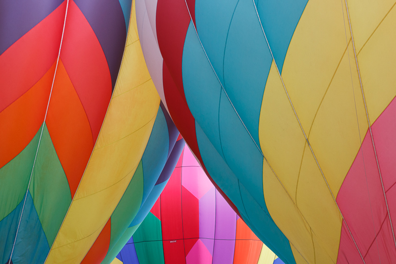Three colorful hot air balloons at the Provo, Utah Freedom Festival on the 4th of July, Independence Day